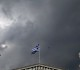 A Greek national flag flutters next to statues of ancient Goddess Athena (L) and God Apollo atop the Athens Academy June 10, 2015. Greece and its creditors moved closer to the brink on Wednesday with the leaders of Germany, France and the European Commission holding back planned meetings with Prime Minister Alexis Tsipras to press for more concessions from the Greek side. REUTERS/Alkis Konstantinidis