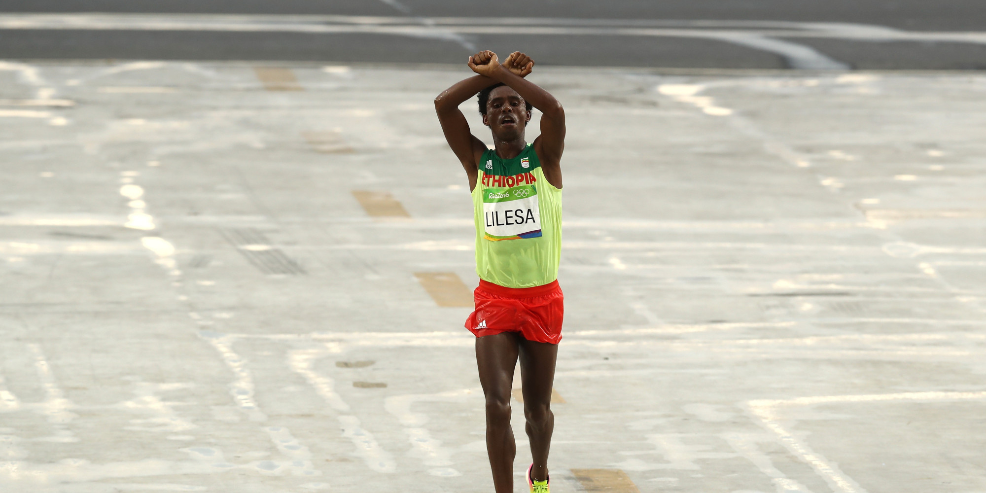 RIO DE JANEIRO, BRAZIL - AUGUST 21:  Feyisa Lilesa of Ethiopia celebrates as he crosses the line to win silver during the Men's Marathon on Day 16 of the Rio 2016 Olympic Games at Sambodromo on August 21, 2016 in Rio de Janeiro, Brazil.  (Photo by Buda Mendes/Getty Images)