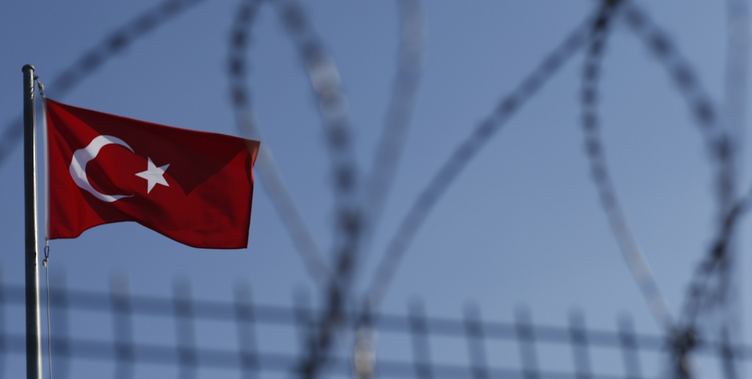 The Turkish flag is seen at the Ipsala border gate with Greece, in Turkey's northwestern province of Edirne, Sunday, Jan. 24, 2016. Academicians, NGO representatives and human right activists from Turkey and Greece demonstrated at the crossing to make a call for opening the borders for the asylum seekers. More than 850,000 asylum-seekers traveled to Greek islands in 2015 on their journey to central and northern Europe, in the continent's worst refugee crisis since World War II. (AP Photo/Emrah Gurel)