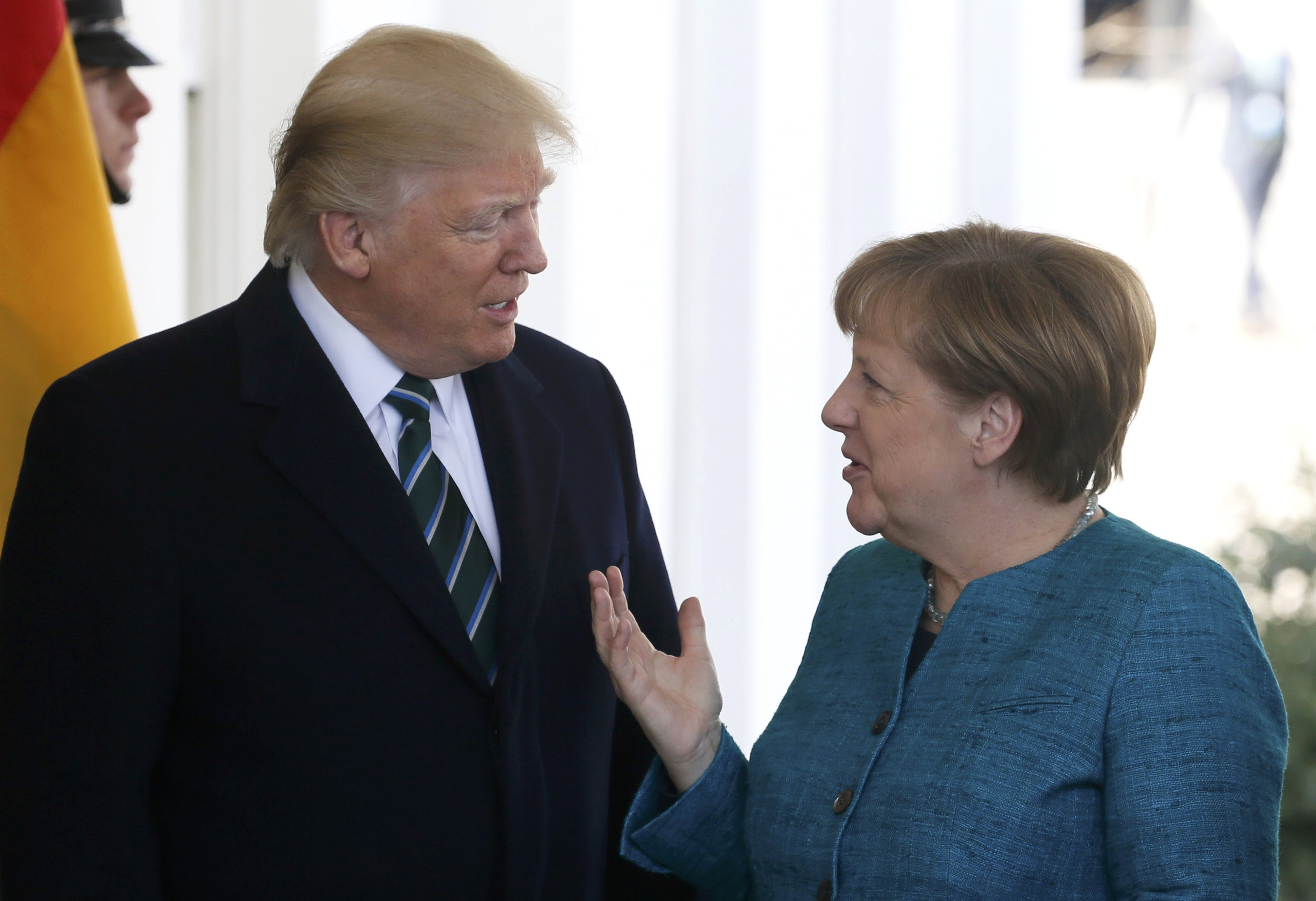 U.S. President Donald Trump welcomes German Chancellor Angela Merkel at the White House in Washington, U.S., March 17, 2017.   REUTERS/Jim Bourg