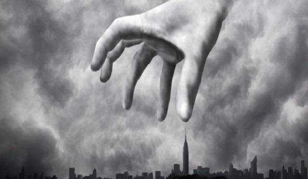 Menacing hand looming over city